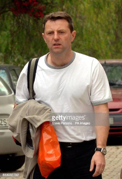 Gerry McCann returns to the apartment where he and his family are staying in Praia Da Luz Portugal after a short visit to the UK