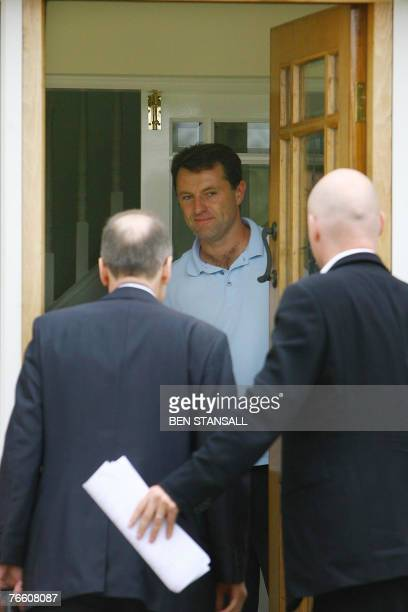 Gerry McCann welcomes unidentified guests into the McCann family home 09 September 2007 following their return from Portugal that day The parents of...