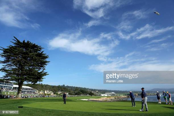 Gerry McIlroy putts on the 18th green during Round Three of the ATT Pebble Beach ProAm at Pebble Beach Golf Links on February 10 2018 in Pebble Beach...