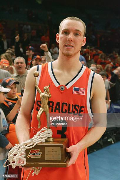 Gerry McNamara of the Syracuse Orange poses with his Big East MVP trophy after defeating the Pittsburgh Panthers 6561 in the Big East Men's...