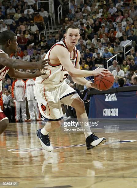 Gerry McNamara of the Syracuse University Orangemen controls the ball against the University of Alabama Crimson Tide during the third round game of...