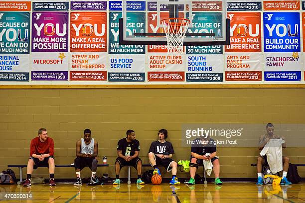 Gerry Pickens 3rd from L chats with Ryan Skurdal between pickup basketball games at the local YMCA on Wednesday March 18 in Puyallup WA Pickens who...