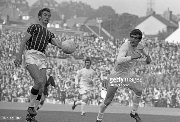 Gerry Queen of Crystal Palace marked by Norman Hunter of Leeds United in the Football League Div 1 match at Selhurst Park on 18th October 1969