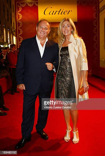Gerry Scotti and guest attend the Cartier Boutique reopening cocktail party on October 5 2012 in Milan Italy