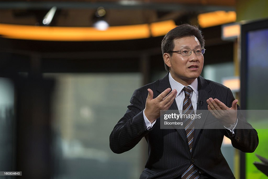 Gerry Wang, chief executive officer of Seaspan Corp., gestures as he speaks during an interview in Hong Kong, China, on Tuesday, Jan. 29, 2013. Seaspan is likely to order another ten to 15 ships within a year, Wang said. Photographer: Jerome Favre/Bloomberg via Getty Images