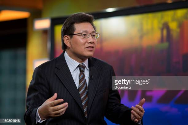 Gerry Wang chief executive officer of Seaspan Corp gestures as he speaks during an interview in Hong Kong China on Tuesday Jan 29 2013 Seaspan is...