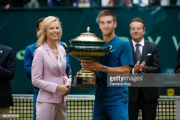 Gerry Weber testimonial international supermodel Eva Herzigova hands over the trophy to tennis player Borna Coric of Croatia during the Gerry Weber...