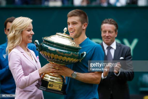 Gerry Weber testimonial international supermodel Eva Herzigova hands the trophy to Borna Coric of Croatia while in the back Ralf Weber CEO Gerry...