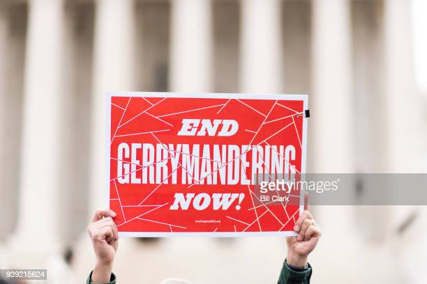 Gerrymandering activists gather on the steps of the Supreme Court as the court prepares to hear the the Benisek v Lamone case on Wednesday March 28...