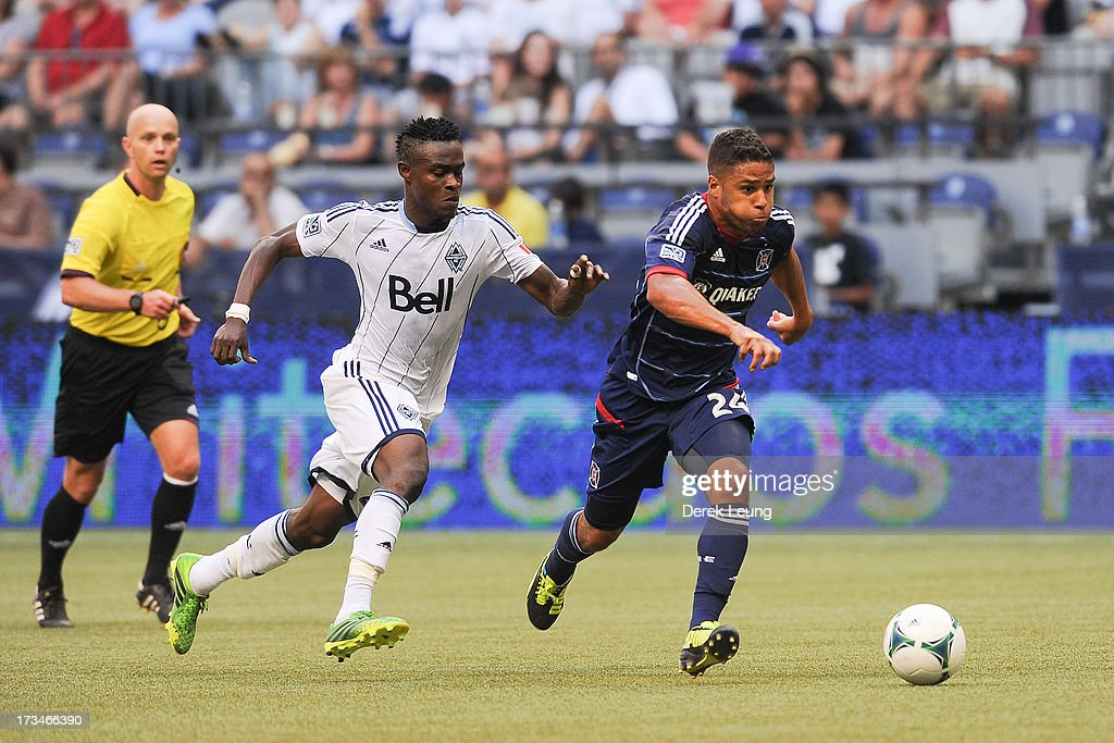 Gershon Koffie #28 of the Vancouver Whitecaps chases Quincy Amarikwa #24 of Chicago Fire during an MLS Match at B.C. Place on July 14, 2013 in Vancouver, British Columbia, Canada. The Vancouver Whitecaps won 3-1.