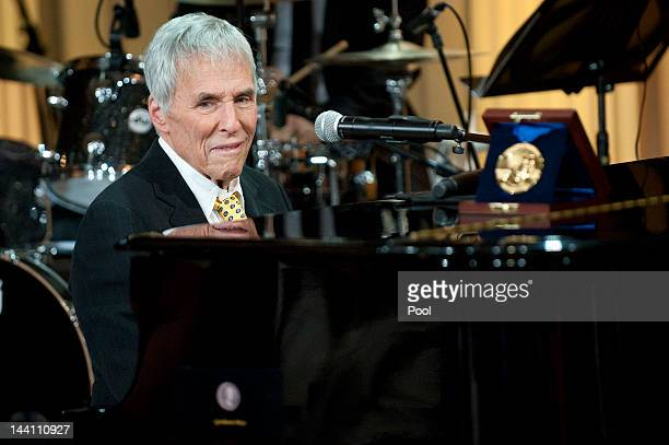 Gershwin Prize recipient Burt Bacharach plays the piano at a concert honoring him and fellow award winner Hal David in the East Room at the White...