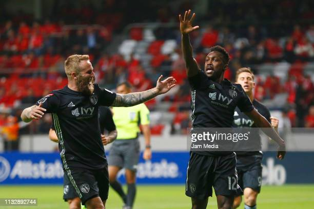 Gerso Fernandes of Sporting Kansas City celebrates with teammate Johnny Russell after scoring the first goal of his team during a round of sixteen...