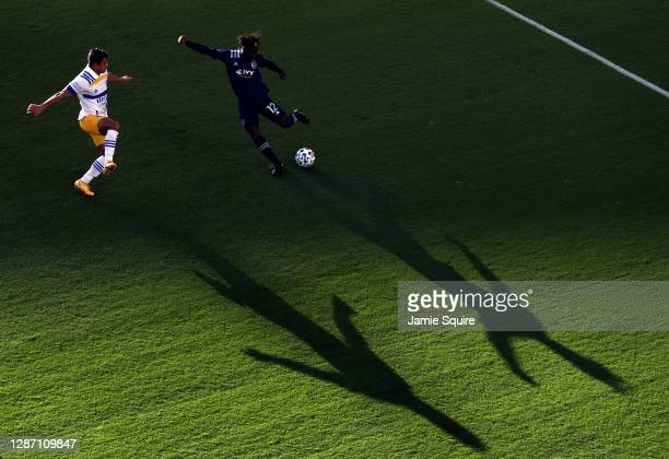 Gerso of Sporting Kansas City crosses the ball as Nick Lima of San Jose Earthquakes defends during the MLS Cup playoff game at Children's Mercy Park...