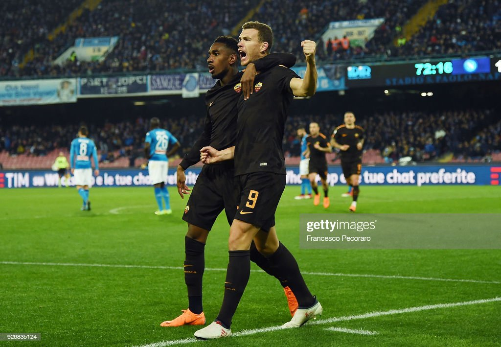 Gerson and Edin Dzeko of AS Roma celebrate the 1-3 goal scored by Edin Dzeko during the serie A match between SSC Napoli and AS Roma - Serie A at Stadio San Paolo on March 3, 2018 in Naples, Italy.