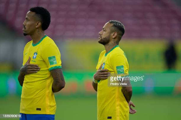 Gerson and Neymar Jr. Of Brazil lines up for the national anthem prior to a match between Brazil and Peru as part of South American Qualifiers for...