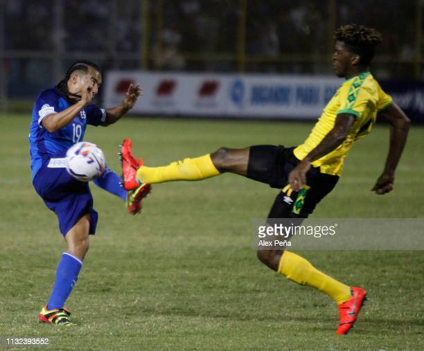 Gerson Mayen of El Salvador battles for the ball with Demion Lowe of Jamaica during a match between El Salvador and Jamiaca as part of the CONCACAF...