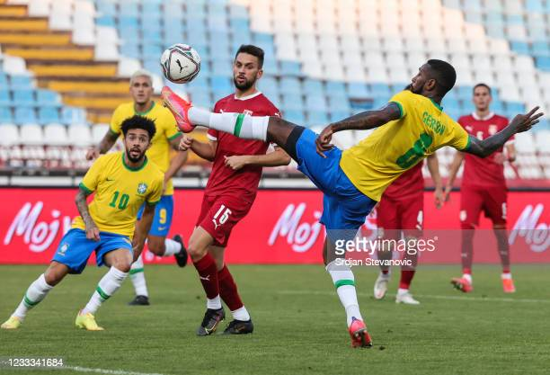 Gerson of Brazil in action against Nikola Marijanovic of Serbia during the International football friendly match between Serbia U21 and Brazil U23 at...