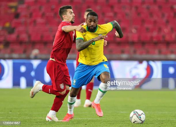 Gerson of Brazil is challenged by Lazar Pavlovic of Serbia during the International football friendly match between Serbia U21 and Brazil U23 at...