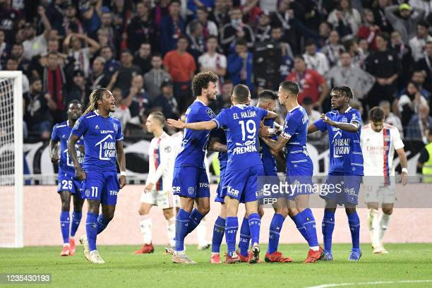 Gerson RODRIGUES - 21 Philippe SANDLER - 06 Rominigue KOUAME during the Ligue 1 Uber Eats match between Lyon and Troyes at Groupama Stadium on...