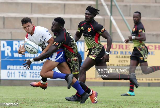 Gerswin Monton of Namibia challenged by Wokorach Philip of Uganda during the 2019 Rugby Africa Mens 7s match between Namibia and Uganda at the Bosman...
