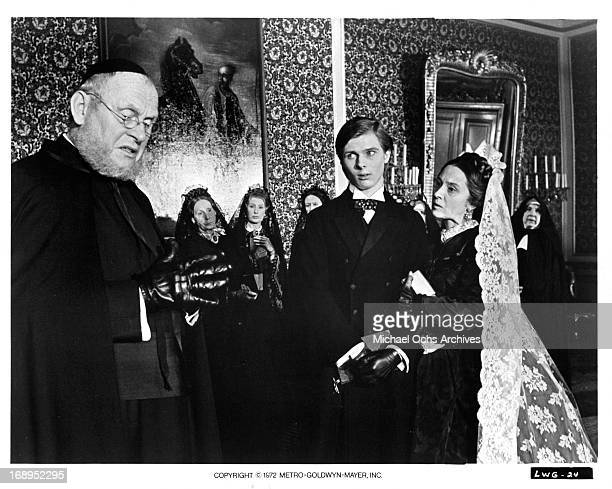 Gert Fröbe is approached by John Moulder Brown and Izabella Telezynska in a scene from the film 'Ludwig' 1972