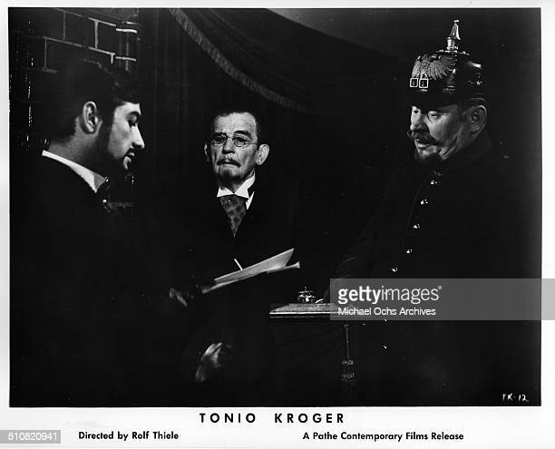 Gert Frobe questions JeanClaude Brialy as Tonio Kroeger in a scene from the movie Tonio Kroeger circa 1964