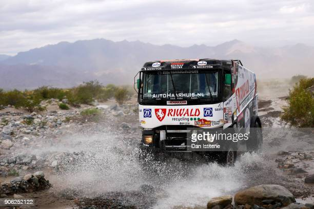 Gert Huzink of the Netherlands and Riwald Dakar drives with codriver Rob Buursen of the Netherlands and mechanic Martin Roesnik of the Netherlands in...