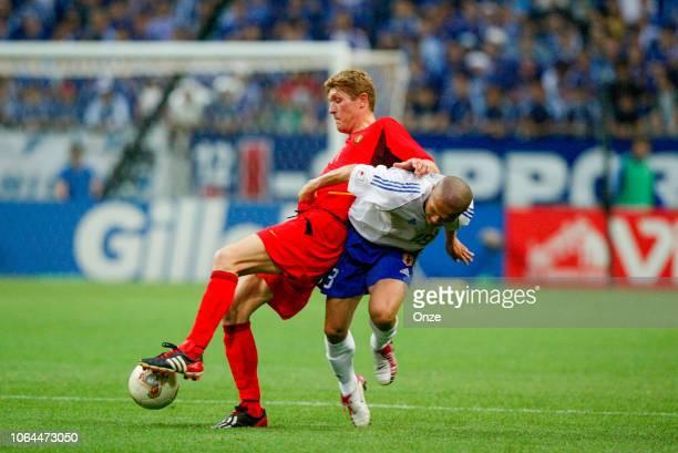 Gert Verheyen of Belgium and Atsushi Yanagisawa of Japan during the World Cup match between Japan and Belgium in Saitama Stadium in Saitama Japan on...