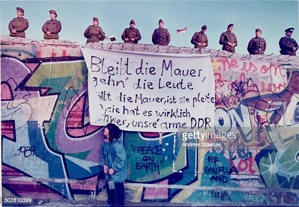 Gerta Klaus 7Asks East Berlin Border Guards when they will leave the Berlin Wall November 11 Color Key Key is blue poster is white with black letters
