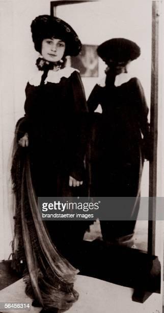 Gerti Schiele by the mirror in Egon Schiele's studio Photography Around 1910 [Gerti Schiele vor dem Spiegel in Egon Schieles Atelier Photographie Um...