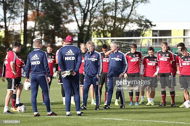 Gertjan Verbeek and Raymond Libregts new coaches of 1 FC Nuernberg welcome the players prior to a practicing session on October 22 2013 in Nuremberg...