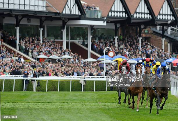 Gertrude Bell and William Buick turn away from the stands before winning The Weatherbys Bank Cheshire Oaks at Chester racecourse on May 05 2010 in...