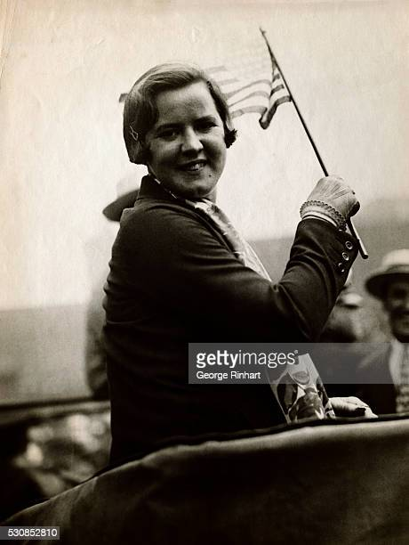 Gertrude Ederle answering the rousing cheers of the crowd that greeted her on her way to City Hall in New York where she was officially greeted by...