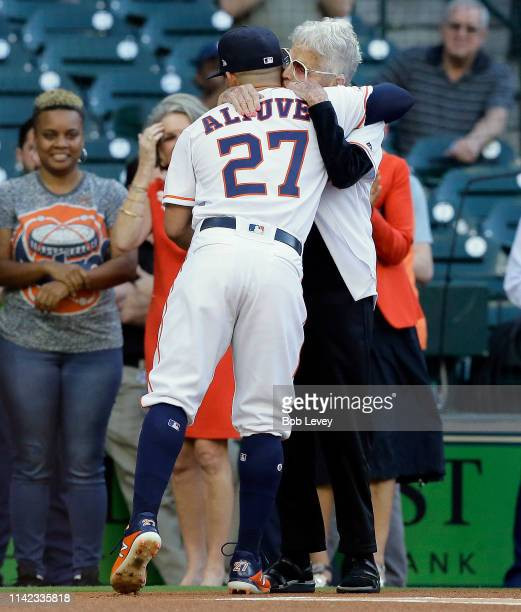 Gertrude Greenfield Houston Astros pitching coach Brent Strom's motherinlaw receives a hug from her favorite player Jose Altuve of the Houston Astros...