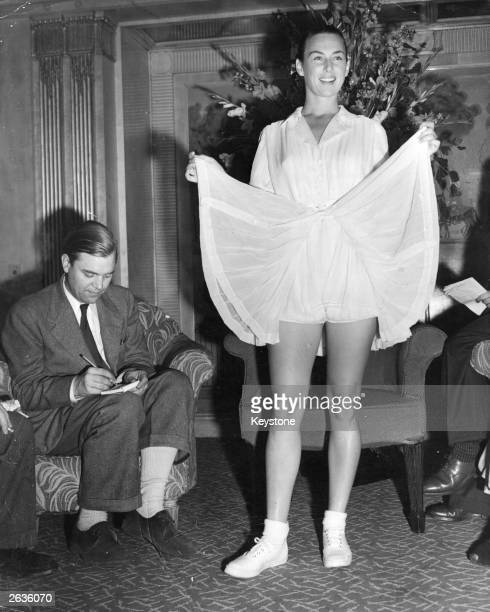 Gertrude 'Gussie' Moran showing off her new bloomer type tennis outfit specially designed for her by Pierre Balmain for the Wimbledon championships