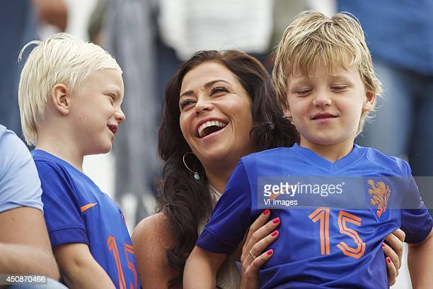 Gertrude Kuyt wife of Dirk Kuyt of Holland with her kids during a training session of The Netherlands on June 19 2014 at Estadio da Gavea in Rio de...
