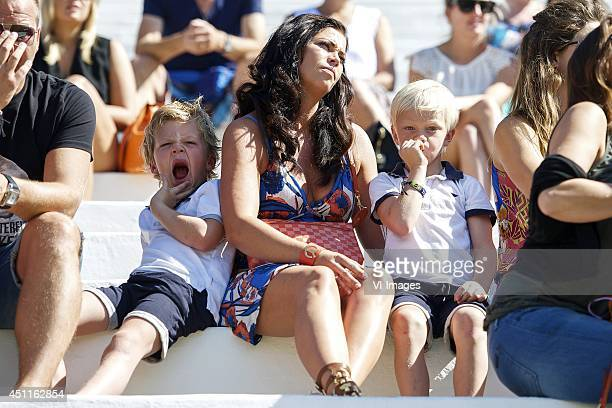 Gertrude Kuyt with kids during a training session of The Netherlands on June 24 2014 at Estadio da Gavea in Rio de Janeiro Brazil