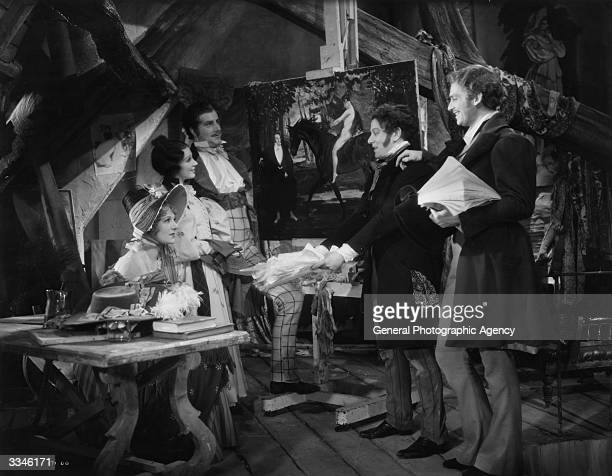 Gertrude Lawrence with Carol Goodner, Harold Warrender, Richard Bird and Douglas Fairbanks Junior in a scene from 'Mimi', a Paul Stein film in...