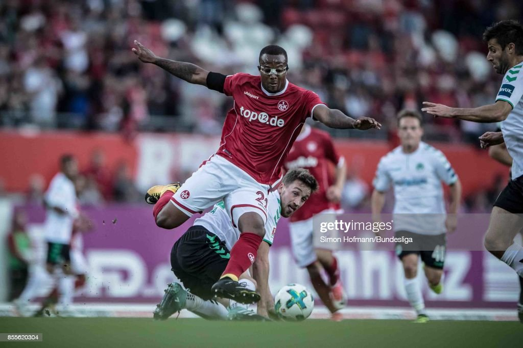 Gervane Kasteneer of Kaiserslautern is tackled by Mario Maloca of Fuerth during the Second Bundesliga match between 1. FC Kaiserslautern and SpVgg Greuther Fuerth at Fritz-Walter-Stadion on September 29, 2017 in Kaiserslautern, Germany.