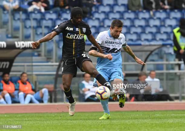 Gervinho and Francesco Acerbi during the Italian Serie A football match between SS Lazio and Parma at the Olympic Stadium in Rome on march 17 2019