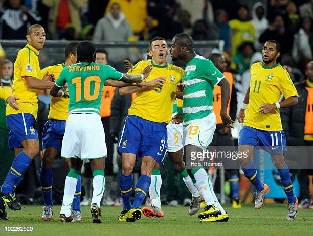 Gervinho and Romaric of the Ivory Coast argue with Lucio of Brazil during the 2010 FIFA World Cup South Africa Group G match between Brazil and Ivory...