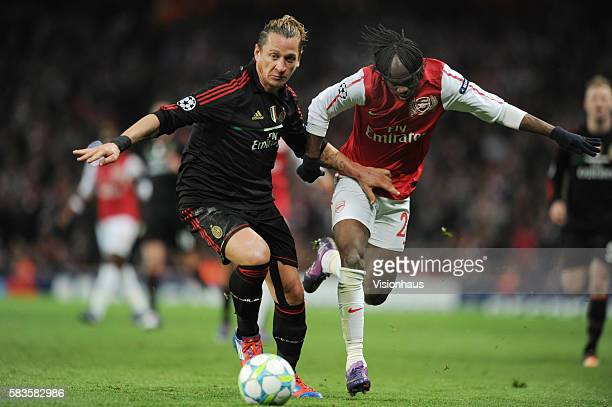 Gervinho of Arsenal and Phillipe Mexes of AC MIlan during the UEFA Champions League First Knockout Round 2nd leg match between Arsenal and AC Milan...