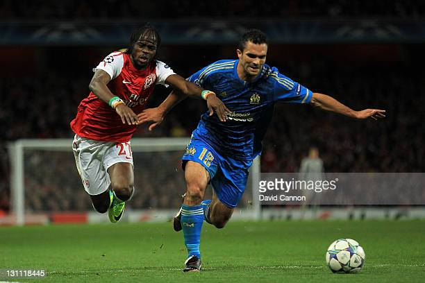 Gervinho of Arsenal battles for the ball withMorgan Amalfitano of Olympique de Marseille during the UEFA Champions League Group F match between...