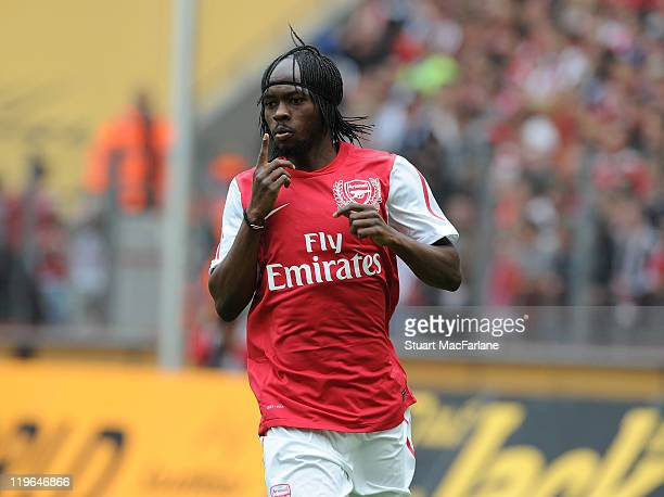 Gervinho of Arsenal celebrates after scoring the opening goal of the pre season friendly match between Cologne and Arsenal at RheinEnergieStadion on...