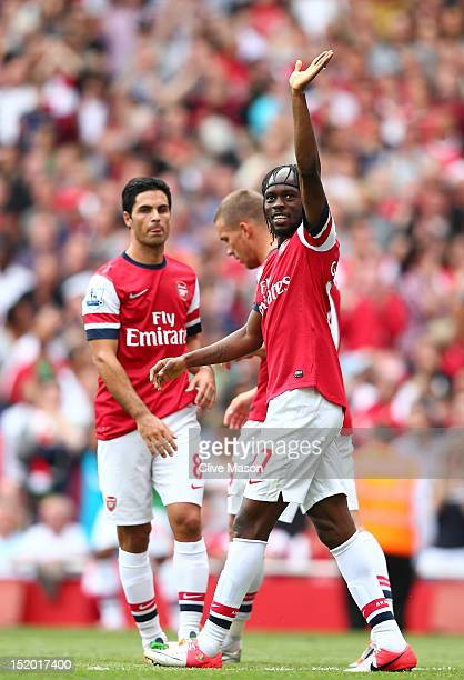 Gervinho of Arsenal celebrates scoring their fifth goal during the Barclays Premier League match between Arsenal and Southampton at Emirates Stadium...