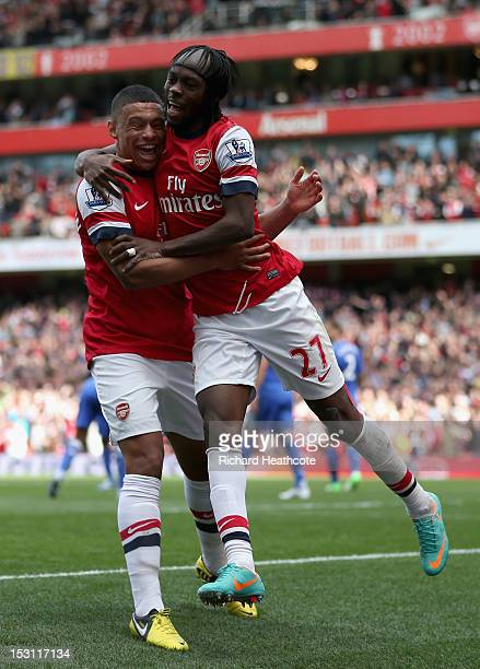 Gervinho of Arsenal celebrates scoring with Alex OxladeChamberlain during the Barclay's Premier League match between Arsenal and Chelsea at the...