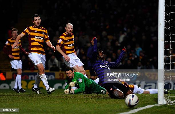 Gervinho of Arsenal reacts after missing a chance on goal during the Capital One Cup quarter final match between Bradford City and Arsenal at the...