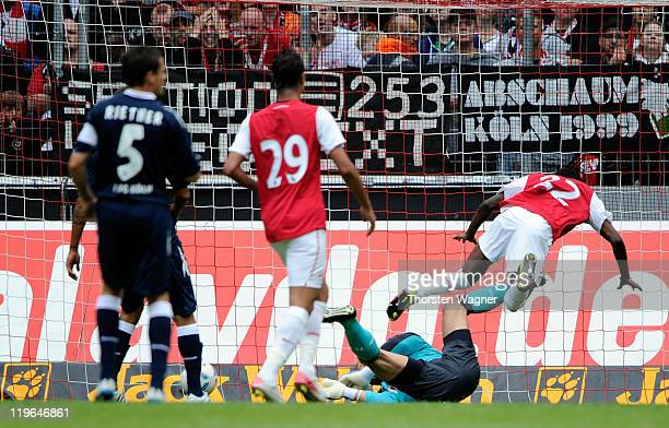Gervinho of Arsenal scores his teams second goal during the International preseason friendly match between 1FC Koeln and Arsenal London at...