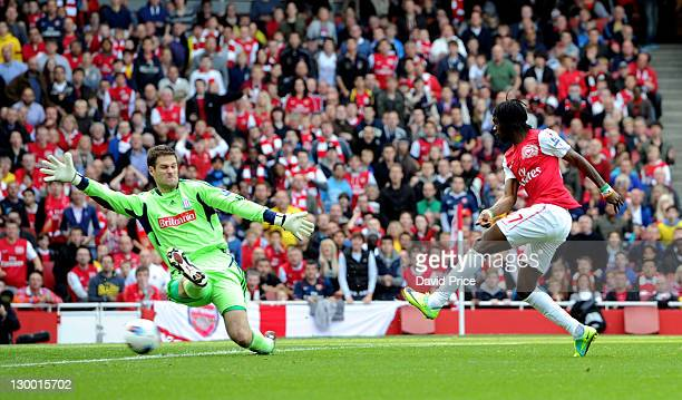 Gervinho of Arsenal scores the first goal past Asmir Begovic of Stoke City during the Barclays Premier League match between Arsenal and Stoke City at...
