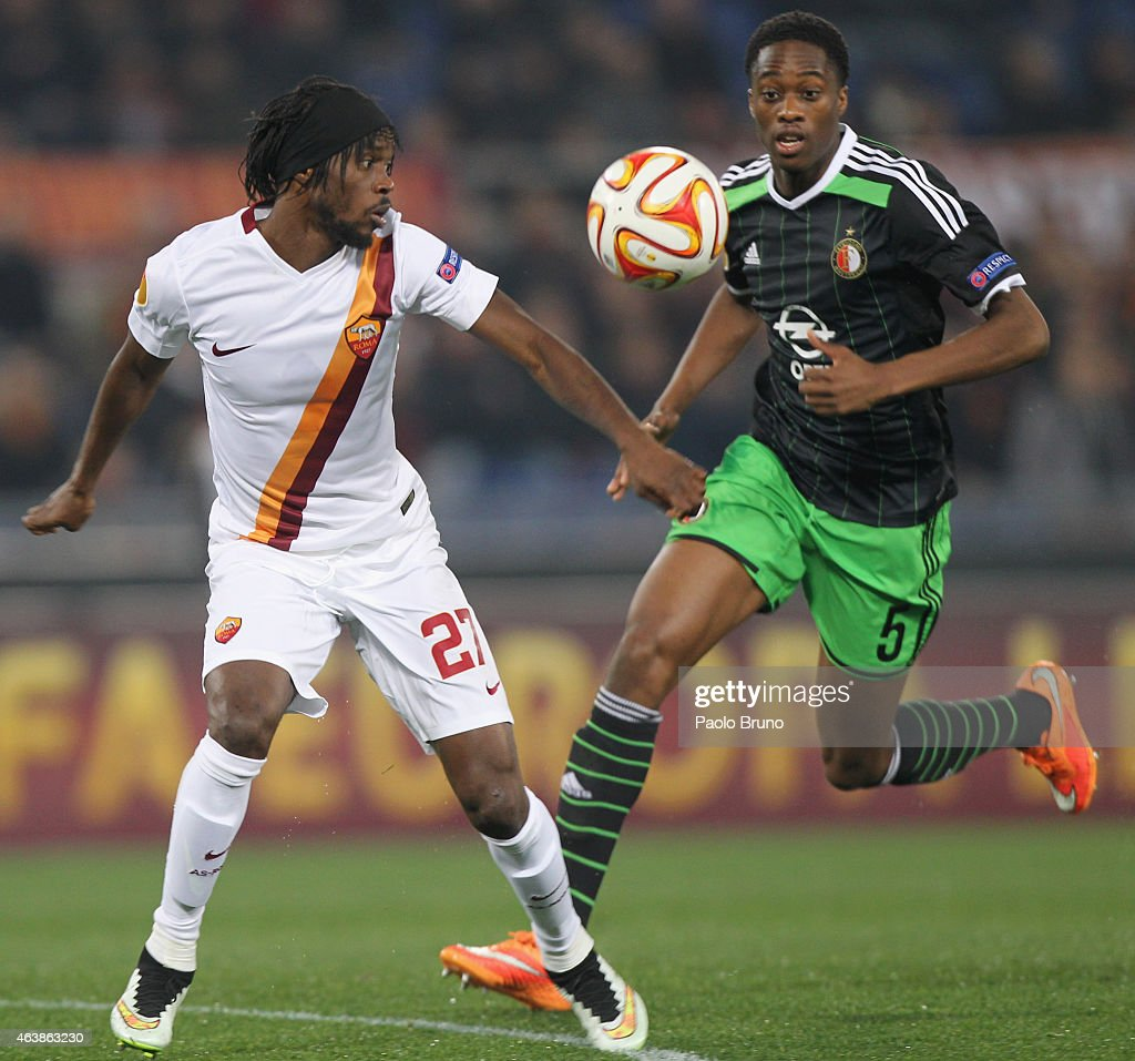 Gervinho (L) of AS Roma competes for the ball with Terence Kongolo of Feyenoord during the UEFA Europa League Round of 32 match between AS Roma and Feyenoord at Olimpico Stadium on February 19, 2015 in Rome, Italy.